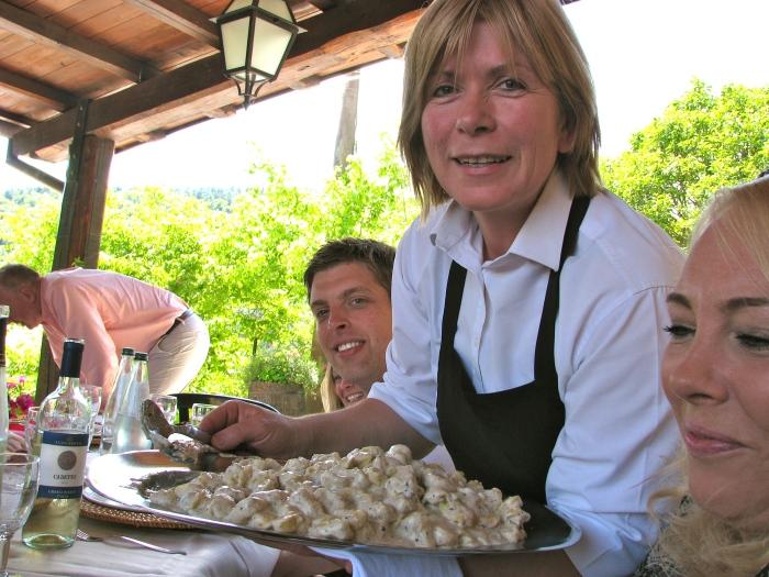 La Signora Roberta serving Tortellini with Truffle Cream Sauce